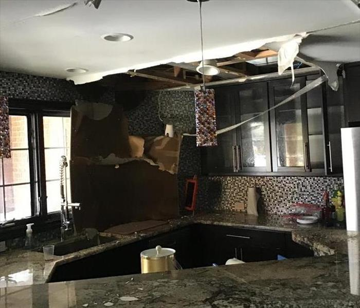 Water loss in kitchen caused ceiling to collapse